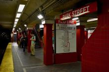 A passenger stands on Park Street's Red Line platform for outbound service from Boston to Cambridge. This line is affected by the suspension of weekend service between Kendall/MIT stations and Park Street through mid-December. Photo Credit: Paige Smith/BU News Service