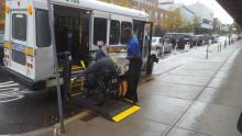 A man enters a handicap accessible vehicle parked in a bike lane in front of Skenderian Apothecary on Cambridge Street on Oct. 5. Some city residents have complained the newly installed bike lanes are creating safety concerns for people who use wheelchairs.  (Photo courtesy of Robert Skenderian)