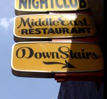 Middle East Downstairs Sign